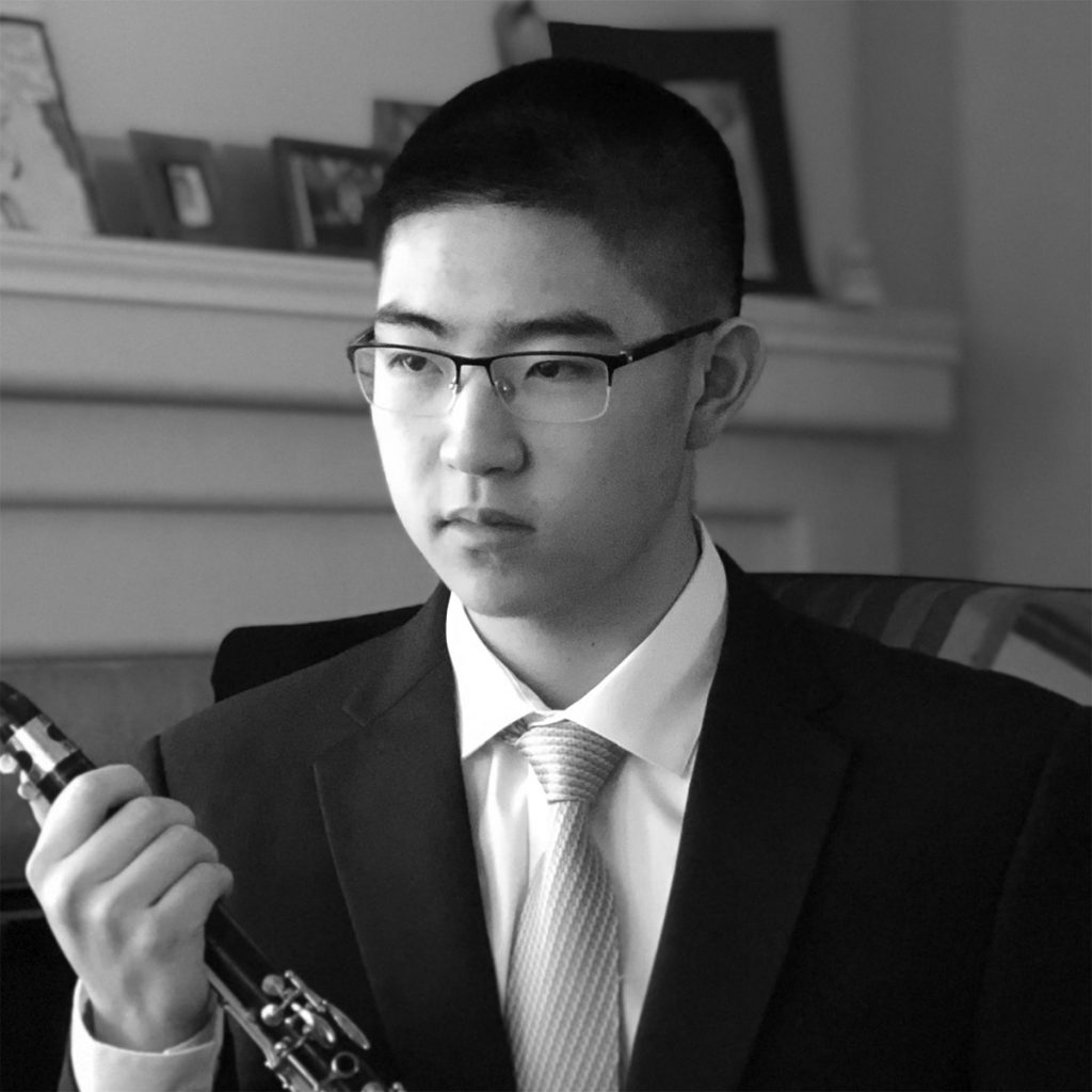 Kyle, 2019 Third Place Young Artist, holding his clarinet.